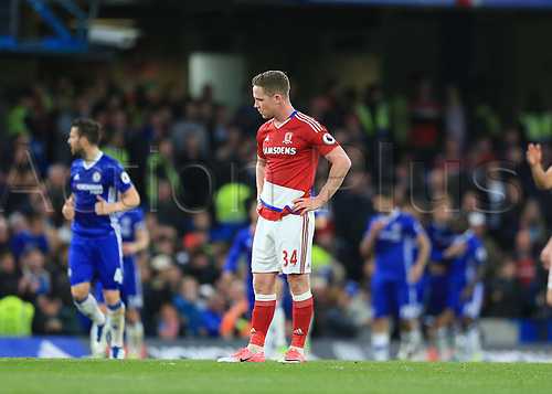 May 8th 2017, Stamford Bridge, Chelsea, London England; EPL Premier League football, Chelsea FC versus Middlesbrough; Adam Forshaw of Middlesbrough shows dejection after Marco Alonso of Chelsea celebrates scoring his teams 2nd goal in the 33rd minute to make it 2-0