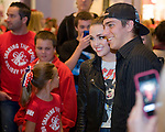 Miley Cyrus poses for a photo with Paul Promen, 18, of Simi Valley on Friday at South Coast Plaza. Back in the summer when he'd been a patient at Children's Hospital in Los Angeles his family had tried to arrange a visit from Cyrus to lift his spirits, but it never worked out. So on Friday, they tricked him into thinking he was meeting a favorfite nurse after dinner at South Coast Plaza, which was how he happened to be holding a single pink rose when he ran into Miley -- her not-so-Christmas-y AC/DC T-shirt -- outside the Rainforest Cafe. He was, as you can imagine, stunned.
