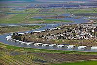 aerial photograph of boat houses along a winding channel in the Sacramento San Joaquin river delta northern California