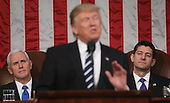 Vice President Mike Pence (L) and Speaker of the House Paul Ryan (R) listen as US President Donald J. Trump (C) delivers his first address to a joint session of Congress from the floor of the House of Representatives in Washington, DC, USA, 28 February 2017.  Traditionally the first address to a joint session of Congress by a newly-elected president is not referred to as a State of the Union.<br /> Credit: Jim LoScalzo / Pool via CNP
