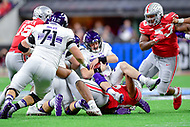 Indianapolis, IN - DEC 1, 2018: Northwestern Wildcats quarterback Clayton Thorson (18) is sacked by Ohio State Buckeyes defensive tackle Dre'Mont Jones (86) during first half action of the Big Ten Championship game between Northwestern and Ohio State at Lucas Oil Stadium in Indianapolis, IN. (Photo by Phillip Peters/Media Images International)