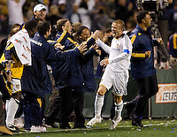LA Galaxy midfielder/captain David Beckham (23) celebrates with the Galaxy bench after scoring a 50 plus yard empty net goal late in the second half during a MLS match. The LA Galaxy defeated the Kansas City Wizards 3-1 at Home Depot Center stadium in Carson, Calif., on Saturday, May 24, 2008.