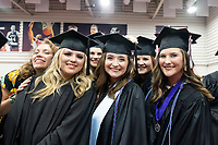 Spring Graduation - first ceremony for the College of Education and the College of Business; graduates lining up in Mize Pavilion before the commencement ceremony at Humphrey Coliseum.<br />  (photo by Megan Bean / &copy; Mississippi State University)