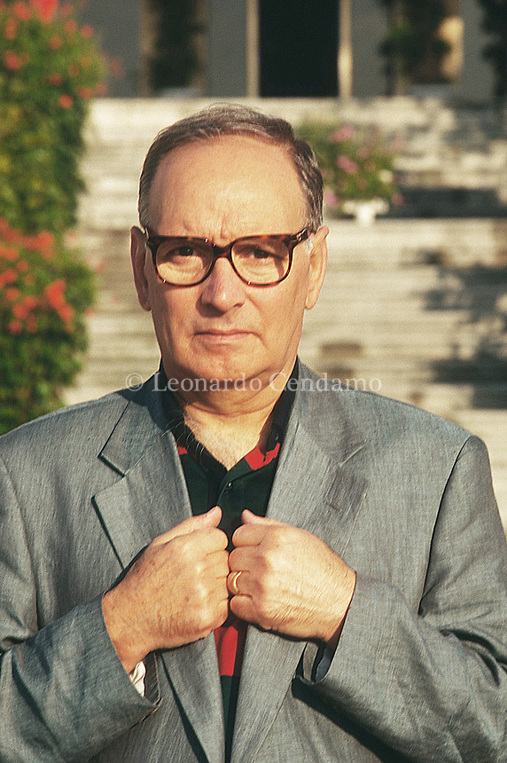 Ennio Morricone è un compositore, musicista e direttore d'orchestra italiano. Con una formazione da trombettista, ha scritto le musiche di più di 500 tra film e serie TV, oltre che opere di musica contemporanea. Ennio Morricone, Grand Officer OMRI (Italian: born 10 November 1928) is an Italian composer, orchestrator, conductor, and former trumpet player, born in Rome. He composes a wide range of music styles, making him one of the most versatile, experimental and influential composers of all time, working in any medium.[1] Over the past 7 decades, Morricone has composed over 500 scores for cinema and television, as well as over 100 classical works. Lido (Venice) settembre 1995. © Leonardo Cendamo