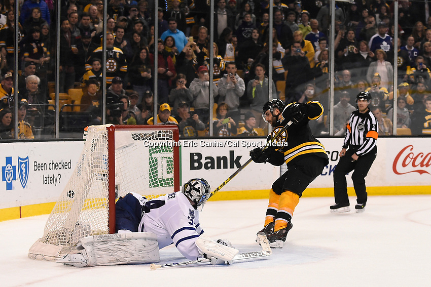 April 4, 2015 - Boston, Massachusetts, U.S. - Boston Bruins center Patrice Bergeron (37) scores the game winning goal against Toronto Maple Leafs goalie James Reimer (34) in a shoot out at the NHL match between the Toronto Maple Leafs and the Boston Bruins held at TD Garden in Boston Massachusetts. The Bruins defeated the Maple Leafs 2-1 in a shoot out. Eric Canha/CSM