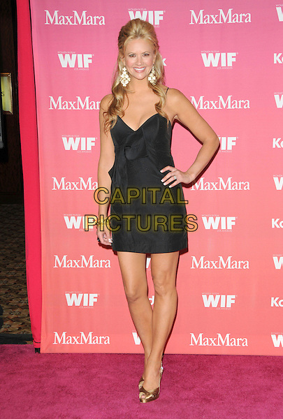 NANCY O'DELL .at The Women in Film 2009 Crystal .and Lucy Awards held at The Hyatt Regency Century Plaza in Century City, California, USA, June 12th 2009                                                                     .full length black dress hand on hip shoes peep toe gold bow .CAP/DVS.©Debbie VanStory/RockinExposures/Capital Pictures