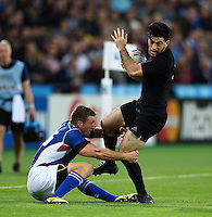 Nehe Milner-Skudder of New Zealand is tackled by Johan Tromp of Namibia. Rugby World Cup Pool C match between New Zealand and Namibia on September 24, 2015 at The Stadium, Queen Elizabeth Olympic Park in London, England. Photo by: Patrick Khachfe / Onside Images