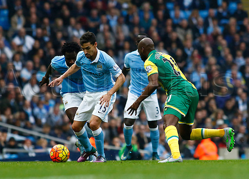 31.10.2015. The Etihad, Manchester, England. Barclays Premier League. Manchester City versus Norwich. Manchester City midfielder Jesús Navas takes on Norwich midfielder Youssuf Mulumbu.