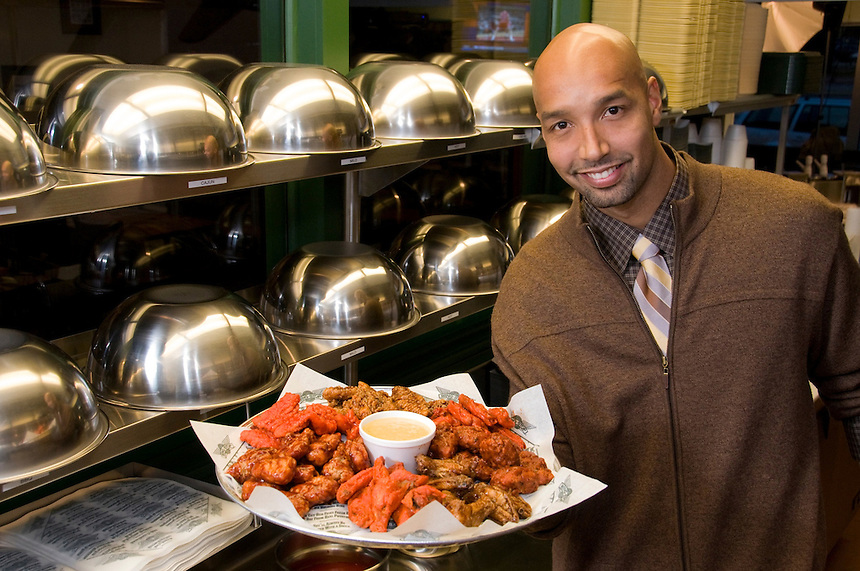 Client: Wing Stop. <br /> Milwaukee Bucks player Drew Gooden with some chicken wings at a Milwaukee Wing Stop in December, 2011. The veteran NBA player is opening four franchises in the Orlanda area.