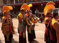 Buddhist monks during the Losar New Year ceremony at a monastery in the Himalayan foothills of Sikkim, India