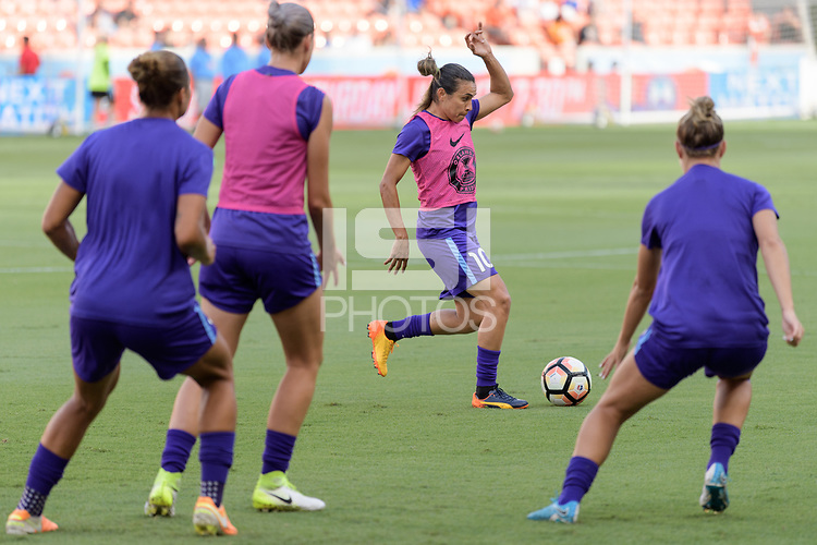 Houston, TX - Saturday June 17, 2017: Marta Vieira Da Silva warming up during a regular season National Women's Soccer League (NWSL) match between the Houston Dash and the Orlando Pride at BBVA Compass Stadium.