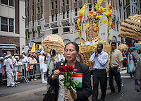 Parishioners from Our Lady of Vailankanni carry their shrine in the Indian Independence Day Parade on Madison Ave. on Sunday, August 18, 2013.  Now in it's 33rd year, the parade celebrates the 66th anniversary of India's partition from British rule on August 15, 1947. (© Richard B. Levine)