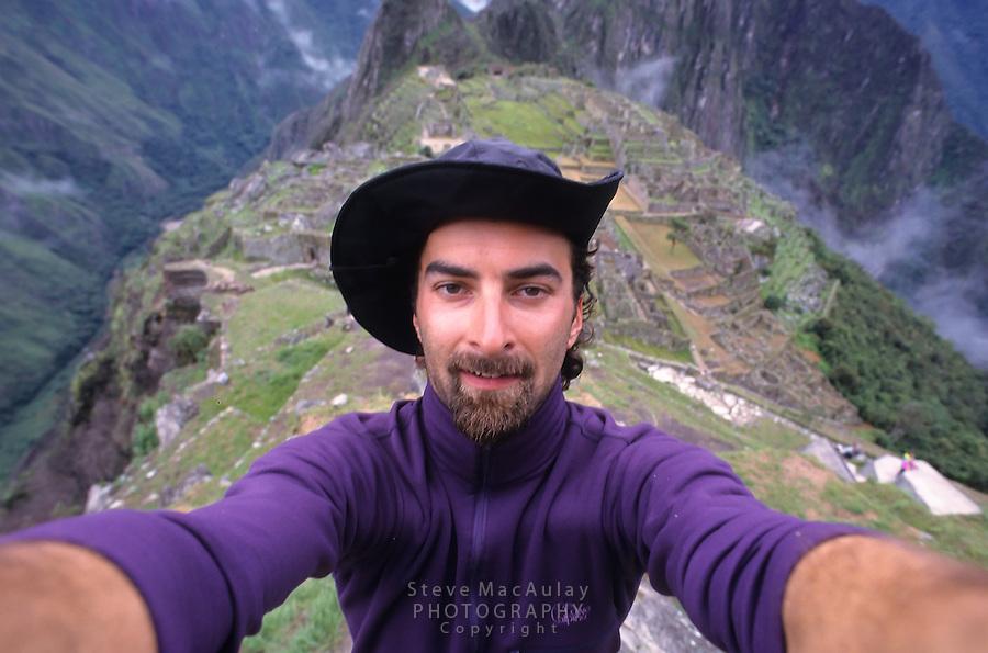 Male traveler with beard taking self portrait at Machu Picchu, Peru