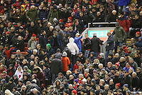 Liverpool fans leave early during the Barclays Premier League match between Liverpool and Swansea City played at The Anfield Stadium on November 29th 2015