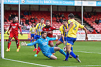Matty Pearson of Accrington Stanley (2) is closed down by Glenn Morris of Crawley Town (12)  during the Sky Bet League 2 match between Crawley Town and Accrington Stanley at Broadfield Stadium, Crawley, England on 22 October 2016. Photo by Edward Thomas / PRiME Media Images.