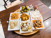 Spain, ESP, Canary Islands, Fuerteventura, Betancuria, 2012Oct14: A diversity of tapas is on a restaurant table at Betancuria.