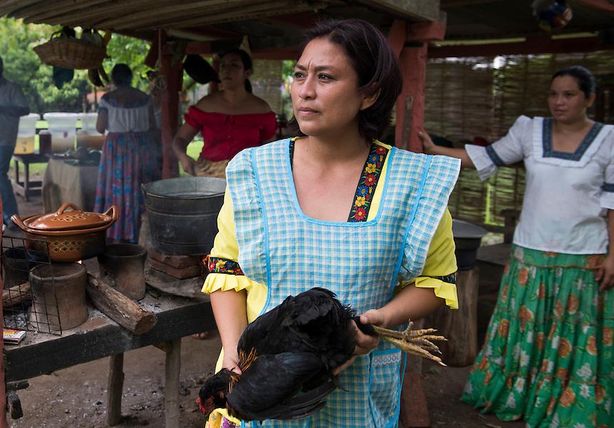 Eva sacrifices a chicken for a caldo at Lunch at Taller la Campesina run by the Embajadoras del Cacao, a cacao plantation and chocolate factory. Tecolutilla, Tabasco, Mexico