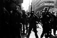 11 AGOSTO 1983<br /> JORNADA DE MOVILIZACION  EN LA CUARTA PROTESTA NACIONAL CONTRA EL REGIMEN MILITAR CONVOCADA POR EL COMANDO NACIONAL DE TRABAJADORES, 18.000 EFECTIVOS MILITARES Y DE CARABINEROS CONTROLARON LAS PROTESTAS REPRIMIENDO LAS MOVILIZACIONES DE ESTUDIANTES, TRABAJADORES Y CIUDADANOS QUE ADHIRIERON A LA CONVOCATORIA DEJANDO UN SALDO DE 26 CIVILES MUERTOS INCLUYENDO 3 NIv?OS,MAS DE CIEN PERSONAS HERIDAS POR ARMAS DE FUEGO Y CERCA 1.000 PERSONAS ARRESTADAS.<br /> <br /> Forty years ago, on September 11, 1973, a military coup led by General Augusto Pinochet toppled the democratic socialist government of Chile. President Salvador Allende was killed during the  attack to seize  La Moneda presidential palace.  In the aftermath of the coup, a quarter of a million people were detained for their political beliefs, 3000 were killed or disappeared and many thousands were tortured.<br /> Some years later in 1981, while Pinochet ruled Chile with iron fist, a young photographer called Juan Carlos Caceres started to freelance in the streets of Santiago and the poblaciones or poor outskirts, showing the growing resistance against the dictatorship. For the next 10 years Caceres photographed every single protest and social movement fighting for the restoration of democracy. He knew that his camera was his only weapon, he knew that his fate was to register the daily violence and leave his images for the History.<br /> In this days Caceres is working to rescue and organize his collection of images in the project Imagenes de la Resistencia   . With support of some Chilean official institutions, thousands of negatives are digitalized and organized to set up the more complete visual heritage of this  violent period of Chile´s history.