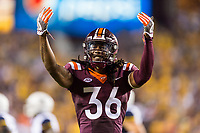 Landover, MD - SEPT 3, 2017: Virginia Tech Hokies cornerback Adonis Alexander (36) gets the crowd hype after a big play during game between West Virginia and Virginia Tech at FedEx Field in Landover, MD. (Photo by Phil Peters/Media Images International)