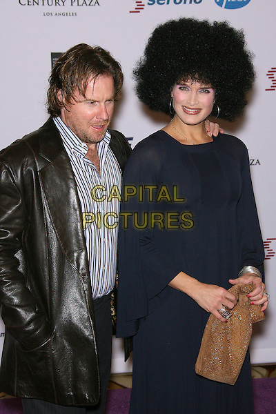 CHRIS HENCHY & BROOKE SHIELDS.13th Annual Race to Erase MS - Arrivals held at the Hyatt Regency Century Plaza Hotel, Century City, California, USA, 12 May 2006..half length afro wig  seventies costume make-up navy blue dress long sleeved dress sleeves gold bag .Ref: ADM/ZL.www.capitalpictures.com.sales@capitalpictures.com.©Zach Lipp/AdMedia/Capital Pictures.