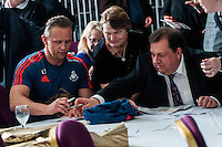 Friday  25 March 2016<br /> Pictured: Lee Trundle and Kev Johns sign autographs at the event <br /> Re: Pen y Bryn Special school  launch their Swansea City FC book at the Liberty Stadium, Swansea, Wales, UK