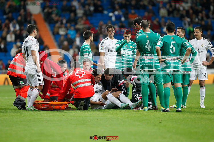 Real Madrid´s medical services assist Sami Khedira after getting injured during Spanish King Cup match between Real Madrid and Cornella at Santiago Bernabeu stadium in Madrid, Spain.December 2, 2014. (NortePhoto/ALTERPHOTOS/Victor Blanco)