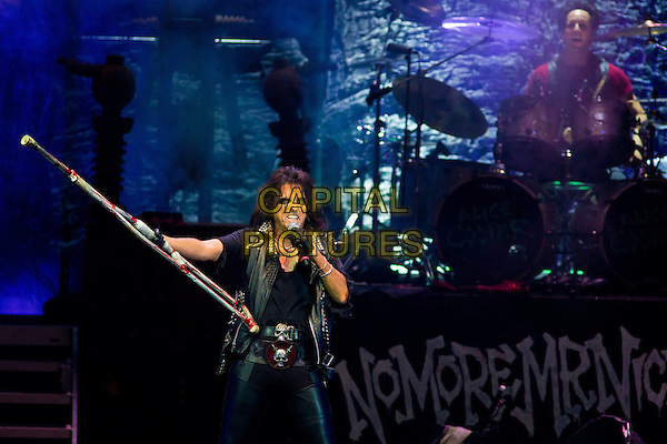 Alice Cooper.Theatre of Death Tour, Crocus City Hall, Moscow, Russia..November 19th, 2011.stage concert live gig performance performing in on half length black jacket  top leather trousers stick crutch crutches singing studs studded .CAP/PER/SB.©SB/PersonaStars/CapitalPictures