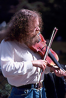 Hippie Busker Musician playing Violin / Fiddle, Vancouver, BC, British Columbia, Canada (No Model Release Available)