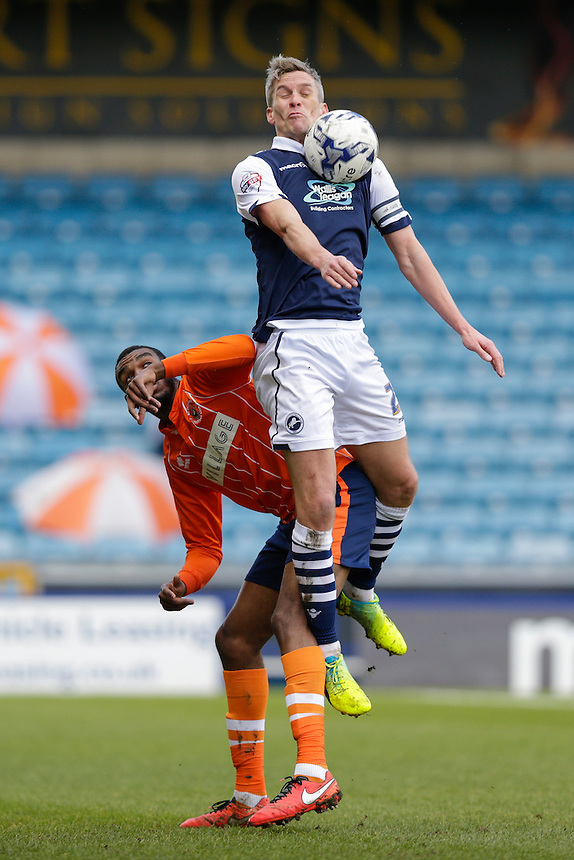 Millwall's Steve Morison wins a challenge with Blackpool's Hayden White<br /> <br /> Photographer Craig Mercer/CameraSport<br /> <br /> Football - The Football League Sky Bet League One - Millwall v Blackpool - Saturday 5th March 2016 - The Den - Millwall<br /> <br /> &copy; CameraSport - 43 Linden Ave. Countesthorpe. Leicester. England. LE8 5PG - Tel: +44 (0) 116 277 4147 - admin@camerasport.com - www.camerasport.com