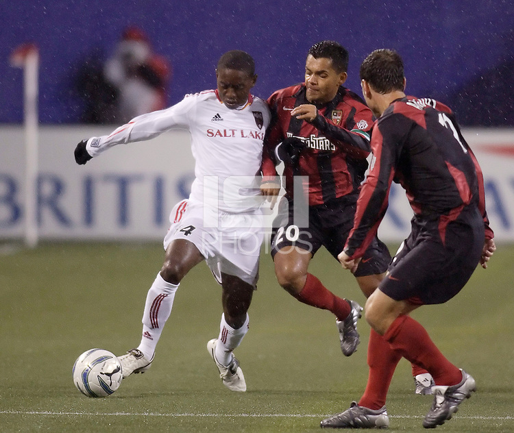 The MetroStars' Amado Guevara challenges Real Salt Lake's Dipsy Selolwane for the ball. The weather was the story with 50 mph winds, rain, and a brief power outage as the MetroStars played Real Salt Lake to a scoreless tie during opening day action of season 10 of the MLS at Giant's Stadium, East Rutherford, on Saturday April 2, 2005.