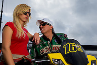 Aug 31, 2014; Clermont, IN, USA; NHRA  funny car driver John Force (right) with daughter Courtney Force during qualifying for the US Nationals at Lucas Oil Raceway. Mandatory Credit: Mark J. Rebilas-USA TODAY Sports