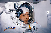 Attired in the extravehicular mobility unit (EMU) space suit,<br /> astronaut Mark C. Lee, payload commander, is in the airlock of Discovery preparing for one of five STS-82 space walks. The sessions of extravehicular activity (EVA), of which Lee eventually participated in three, were conducted in order to service the Huhble Space<br /> Telescope (HST), temporarily latched in Discovery's payload bay.<br /> Credit: NASA via CNP