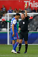 (L-R) Andre Dozzell of Ipswich Town sees a yellow card referee Oliver Langford during the Sky Bet Championship match between Swansea City and Ipswich Town at the Liberty Stadium, Swansea, Wales, UK. Saturday 06 October 2018