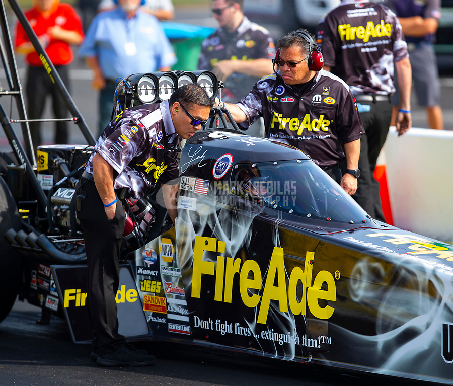 May 4, 2018; Commerce, GA, USA; Crew chief Todd Okuhara (right) and brother Scott Okuhara for NHRA top fuel driver Leah Pritchett during qualifying for the Southern Nationals at Atlanta Dragway. Mandatory Credit: Mark J. Rebilas-USA TODAY Sports