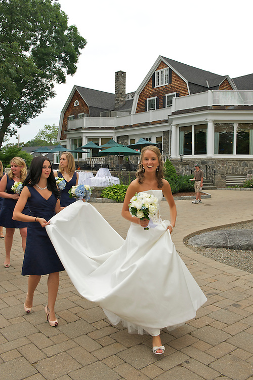The bride walking to the golf course for pictures accompanied by her bridesmaids.