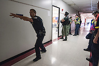 Westerville, Genoa and Ohio State university police officers and the Westerville Fire Department train at a high school to refine their procedures and policies for school violence..