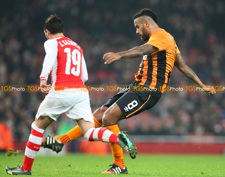 Tom Huddlestone of Hull City and Santi Cazorla of Arsenal - Arsenal vs Hull City - FA Cup third round action at the Emirates Stadium on 04/01/2015 - MANDATORY CREDIT: Dave Simpson/TGSPHOTO - Self billing applies where appropriate - 0845 094 6026 - contact@tgsphoto.co.uk - NO UNPAID USE
