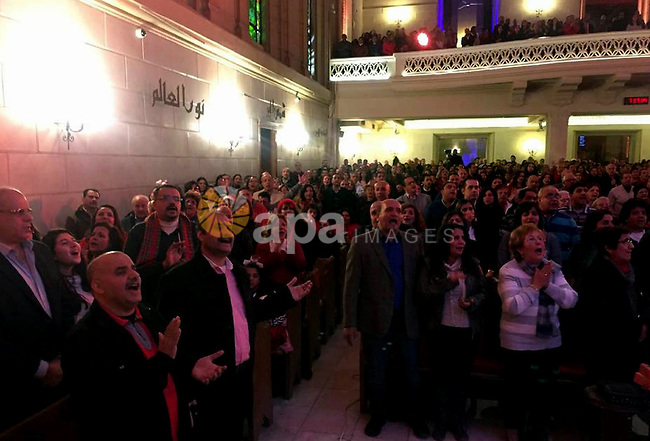 Egyptian Christians attend a religious mass at the Kasr El Dobara Evangelical Church to celebrate New year in Cairo, Egypt on December 31, 2016. Photo by Stringer