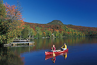 canoeing, canoe, Vermont, VT, Mother and daughter paddling a red canoe on Long Pond in Westmore in the fall.