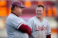 SANTA CLARA, CA - April 19, 2011: Zach Jones of Stanford baseball talks with third base coach Dean Stotz during a break for an injury to the home plate umpire during Stanford's game against Santa Clara at Stephen Schott Stadium. Stanford won 10-3.