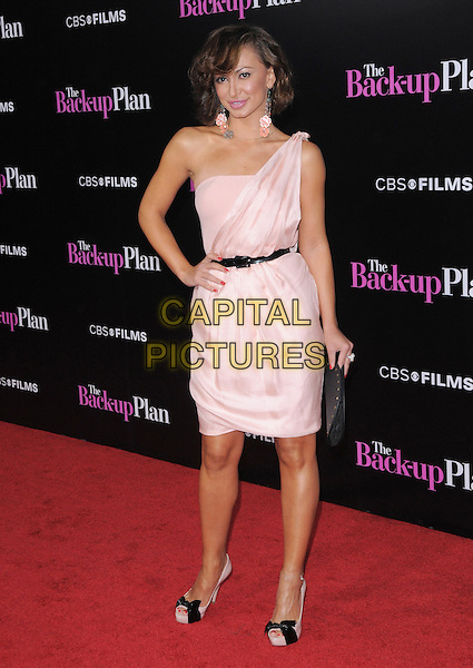 "KARINA SMIRNOFF .at the CBS Films' L.A. Premiere of ""The Back-Up Plan"" held at The Village Theatre in Westwood, California, USA, April 21st, 2010..arrivals full length pink one shoulder dress hand on hip black waist belt peep toe shoes bows clutch bag .CAP/RKE/DVS.©DVS/RockinExposures/Capital Pictures."