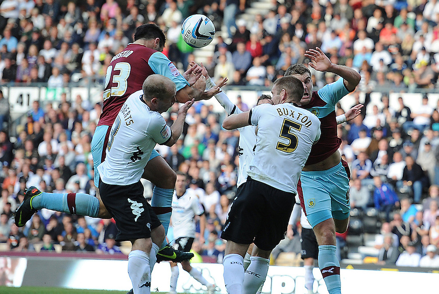 Burnley's Charlie Austin beats Derby County's Gareth Roberts to the ball and scores his and his sides second goal in the last minutes of the match to secure a 2-1 victory ..Football - npower Football League Championship - Derby County v Burnley - Saturday 22nd September 2012 - Pride Park - Derby..