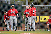Illinois State Redbirds Jack Czeszewski (25) congratulated by Joe Kelch (3) and Dennis Colon (1) after scoring a run during a game against the Georgetown Hoyas on March 7, 2015 at North Charlotte Regional Park in Port Charlotte, Florida.  Illinois State defeated Georgetown 2-1.  (Mike Janes/Four Seam Images)