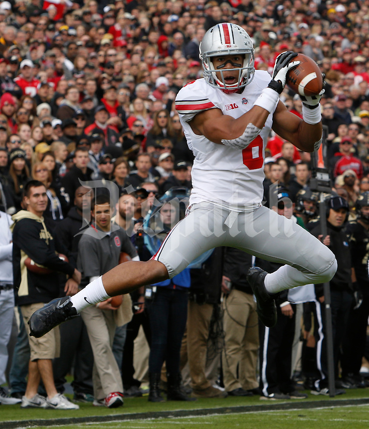 Ohio State Buckeyes wide receiver Evan Spencer (6) leaps to catch  a pass during Saturday's NCAA Division I football game against Purdue at Ross-Ade Stadium in West Lafayette, In. on November 2, 2013. (Barbara J. Perenic/The Columbus Dispatch)
