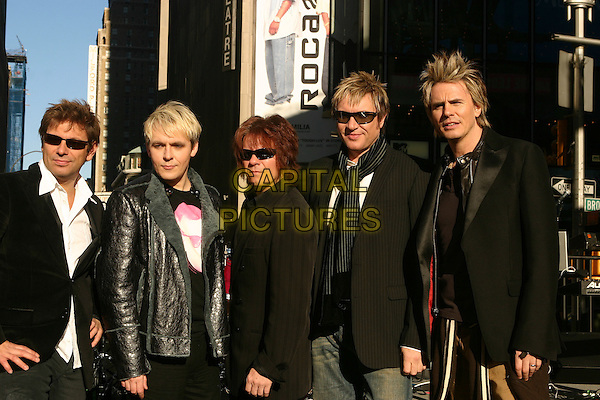 DURAN DURAN.ROGER TAYLOR, NICK RHODES, ANDY TAYLOR ,SIMON LE BON & JOHN TAYLOR .Perform on ABC's Good Morning America Concert Series in New York City, USA, October 12 th 2004..half length sunglasses.Ref: IW.www.capitalpictures.com.sales@capitalpictures.com.©Ian Wilson/Capital Pictures .