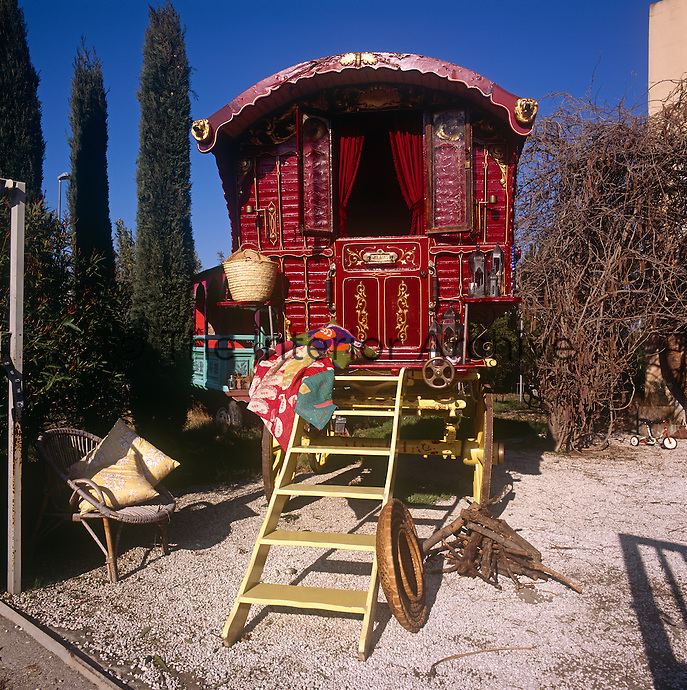 The exterior of a red painted traditional Romany caravan, also known as a Vardo.