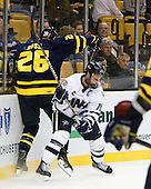 Adam Ross (Merrimack - 26), Mike Sislo (UNH - 19) - The Merrimack College Warriors defeated the University of New Hampshire Wildcats 4-1 (EN) in their Hockey East Semi-Final on Friday, March 18, 2011, at TD Garden in Boston, Massachusetts.