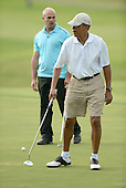 United States President Barack Obama walks on the green of the 18th hole at the Mid Pacific Country Club in Lanikai, Hawaii on January 1, 2014.  The President's friend, Sam Kass, looks on.<br /> Credit: Cory Lum / Pool via CNP