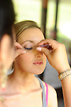 The bride's eyelashes while preparing for her wedding.