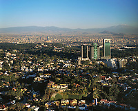 aerial photograph of Las Lomas district Mexico City toward the Popocatepetl and Iztaccihuatl volcanoes